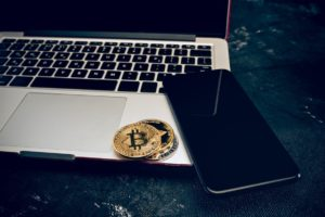 the golden bitcoin on keyboard PJXSBK
