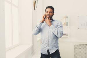 businessman phone talking on phone near window PPGVKL