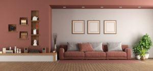 modern living room with sofa and niche on wall XBQPLFC