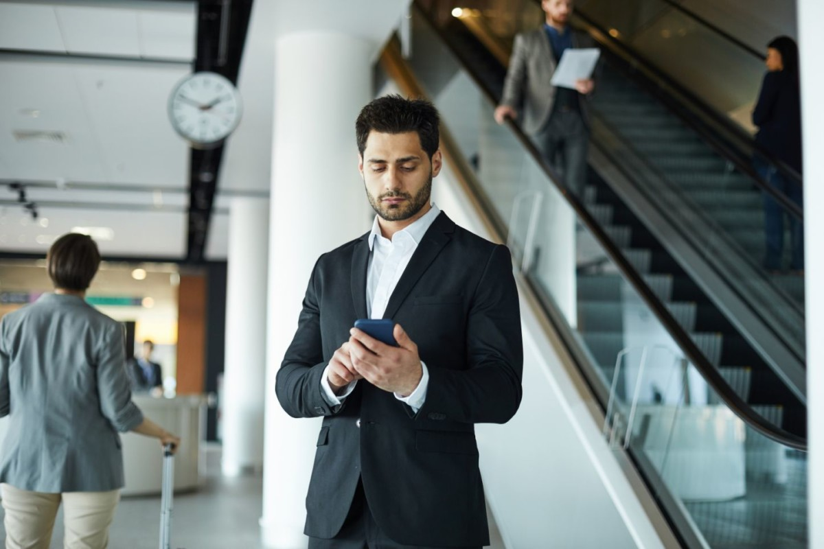 handsome businessman browsing internet EHNCM