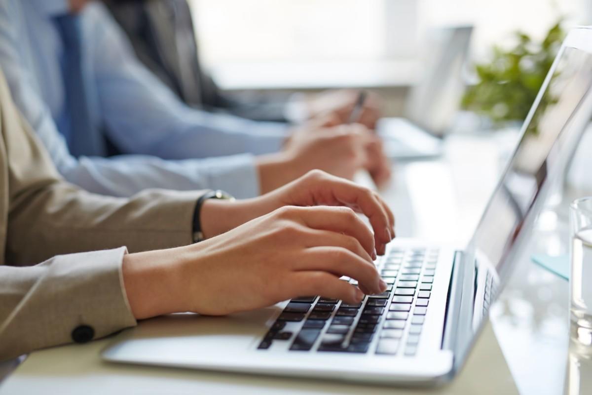 typing on laptop PNRLGY