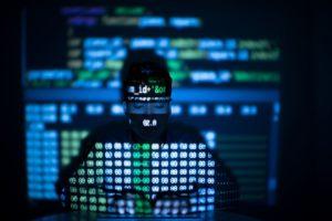 anonymous hacker in glowing computer interface XLDCJD