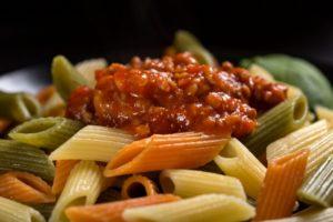 colored penne pasta with ragu sauce PLRC