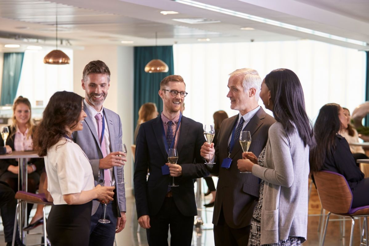 delegates-networking-at-conference-drinks-PLCKMY7