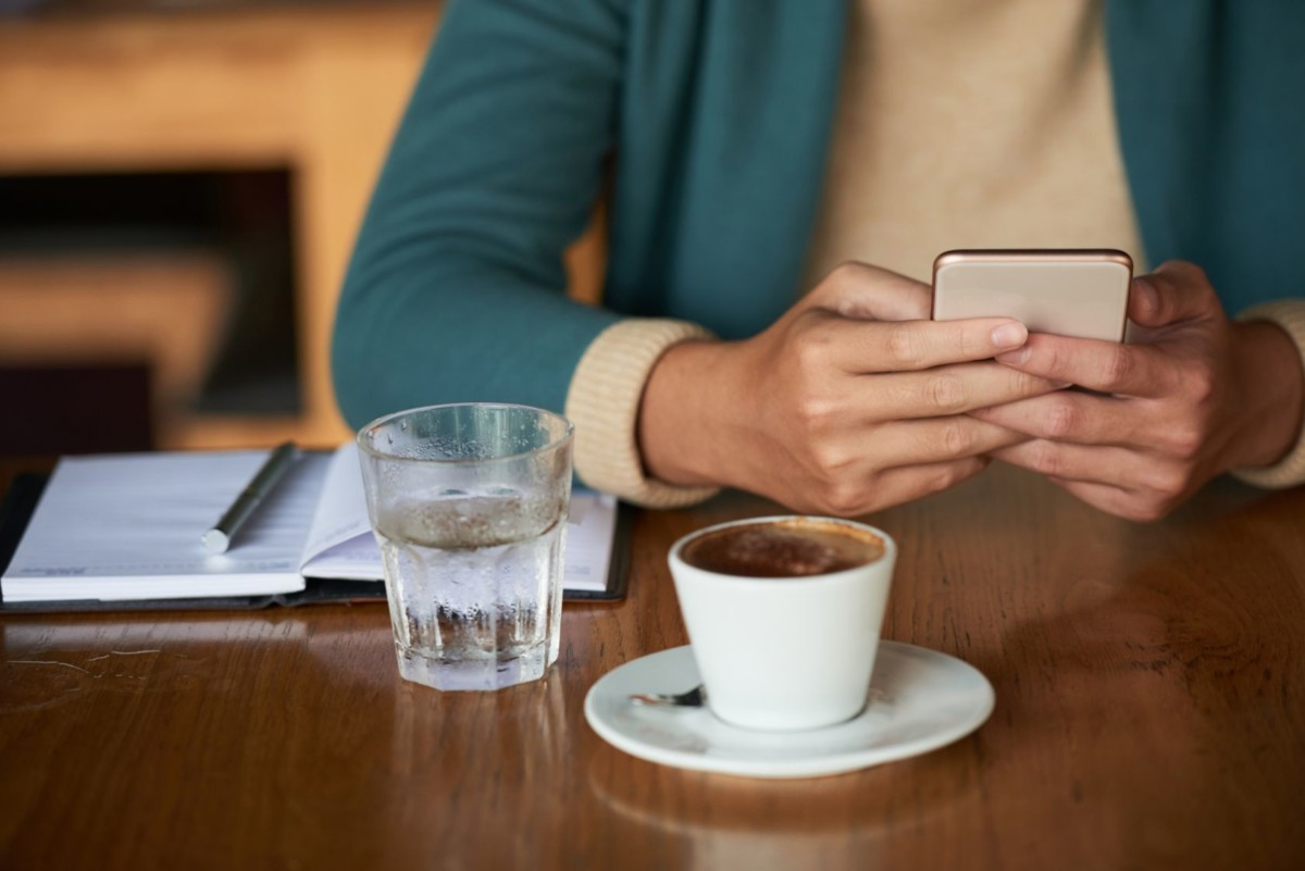 drinking espresso and checking social media FZPUF