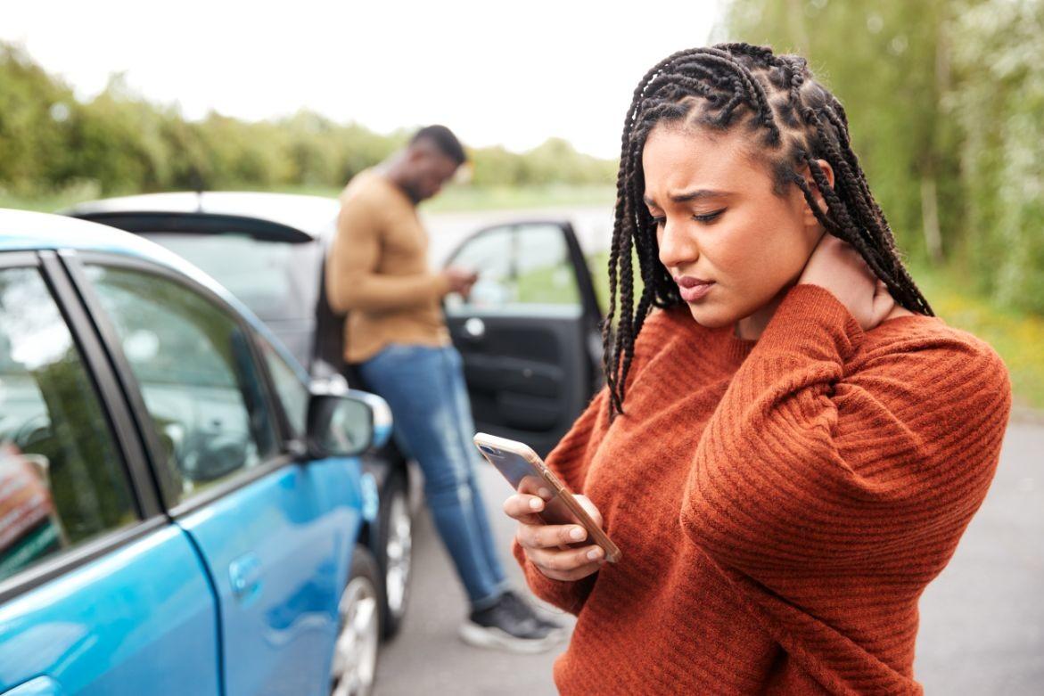female-motorist-involved-in-car-accident-calling-XAV43ZW
