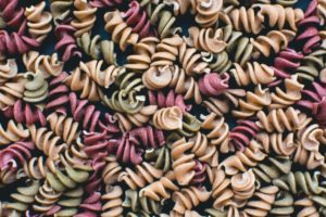 full frame of colorful pasta fusili TURQ