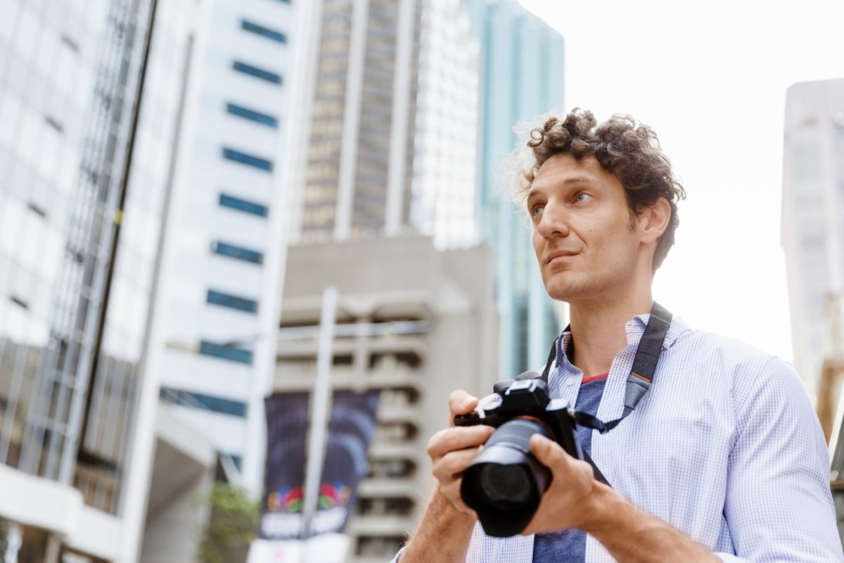 male-photographer-taking-picture-PDJNAK9