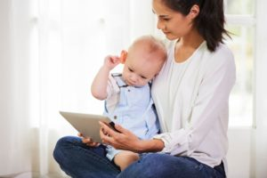 mother showing cartoon to baby FWCR