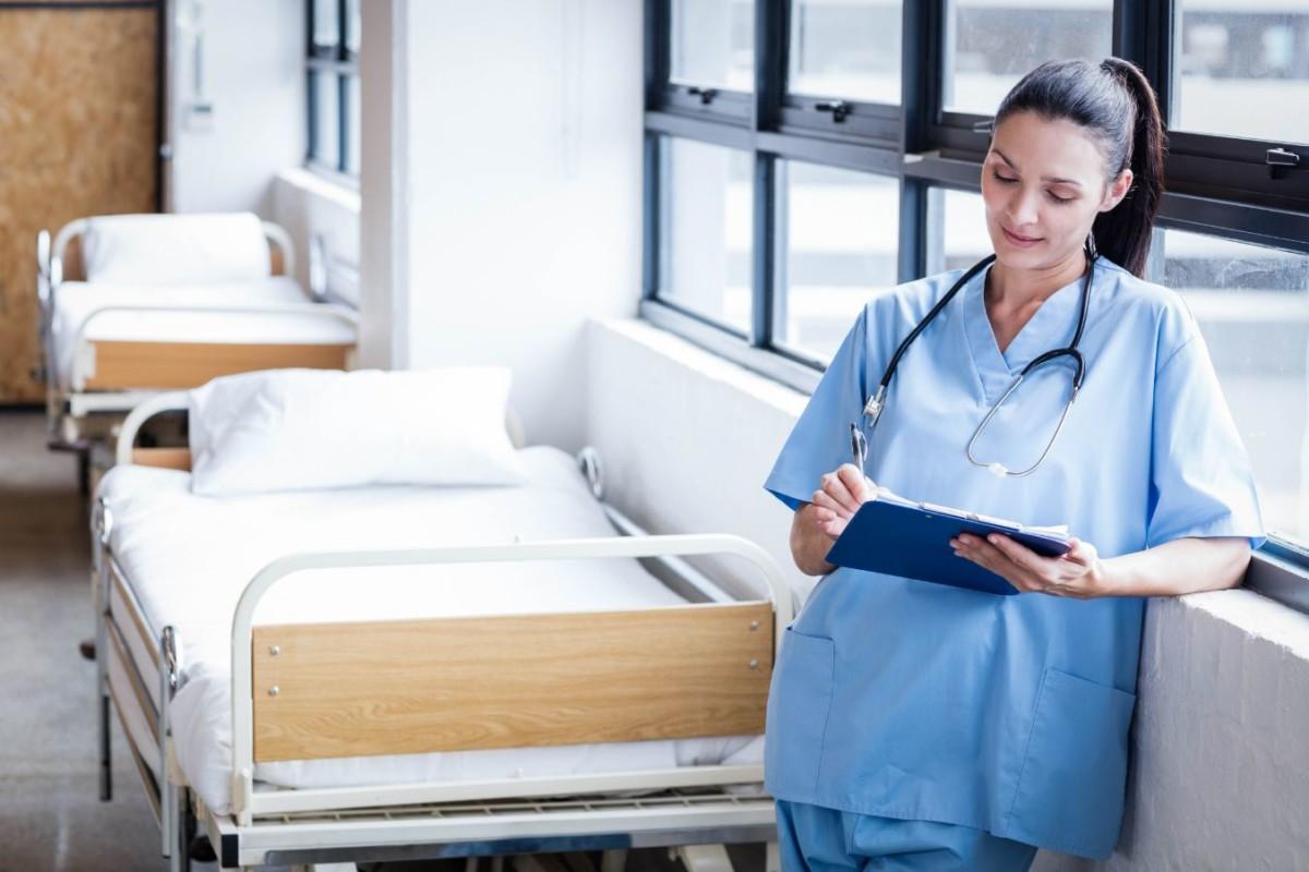 nurse writing on a clipboard in the hospital PZPXL