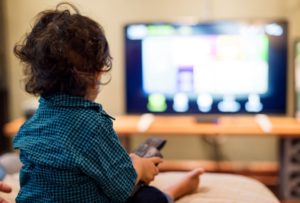 young indian boy watching television PCFTJE