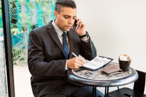 business man calling mobile phone concept PXNSZ