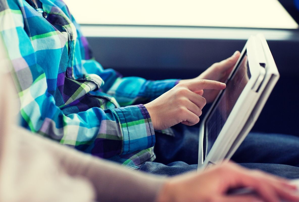 close up of boy with tablet pc in travel bus PDRZVS