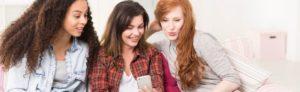 friends browsing internet on smartphone PHDP