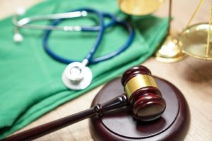 gavel and stethoscope medical jurisprudence legal definition of medical malpractice attorney common t NxRNnn