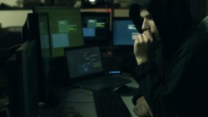 hacker hiding in the dark and working with HULAN
