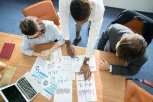 marketing team analyzing statistics at meeting SBKCZ