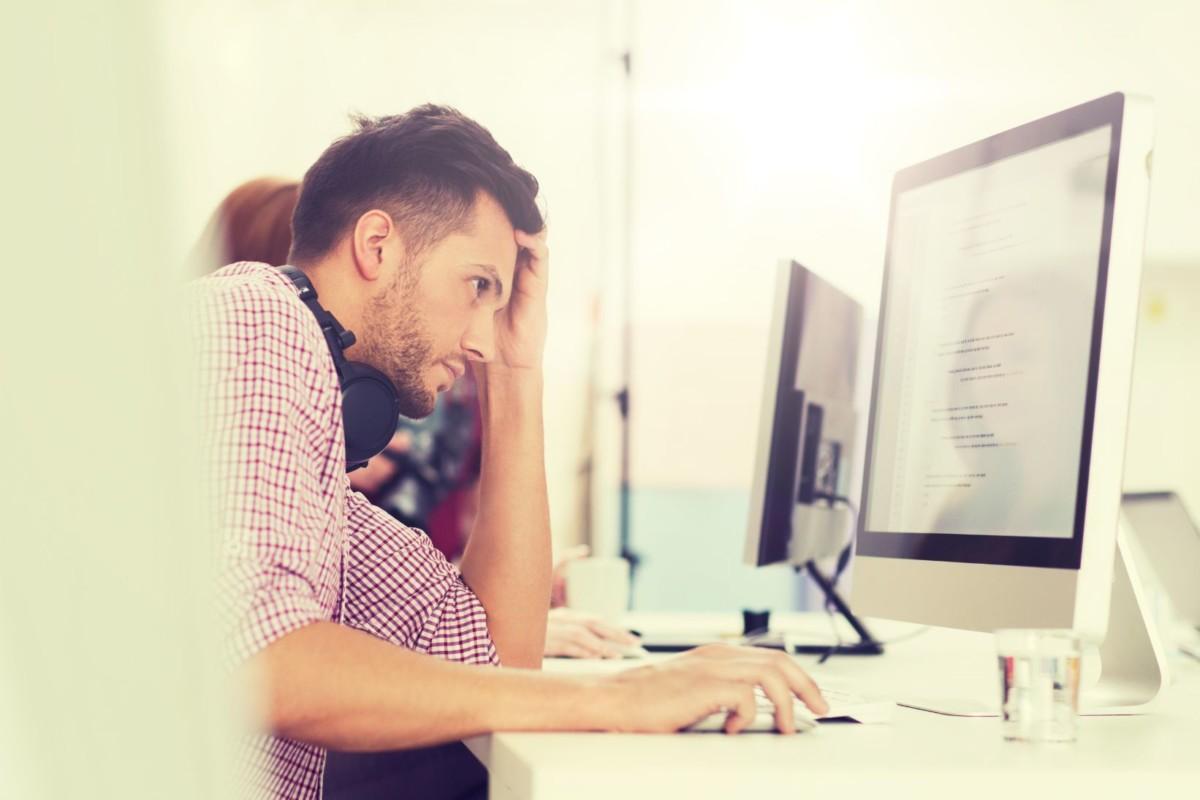 stressed software developer at office PNPUT
