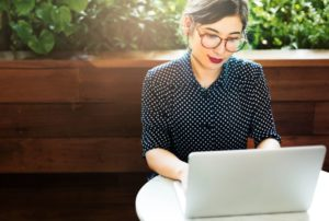 young woman browsing internet laptop concept PFXMWMN