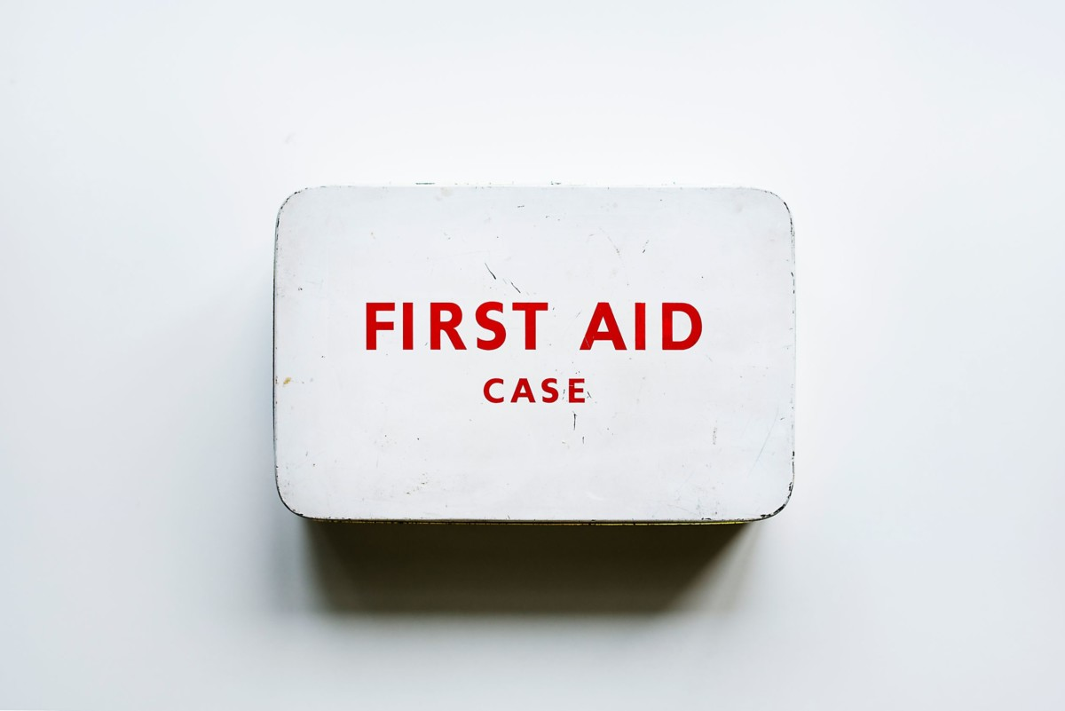 aerial-view-of-first-aid-case-on-white-table-P966BCT
