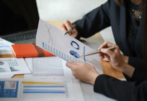 female accountant team is analyzing data QFCJVU