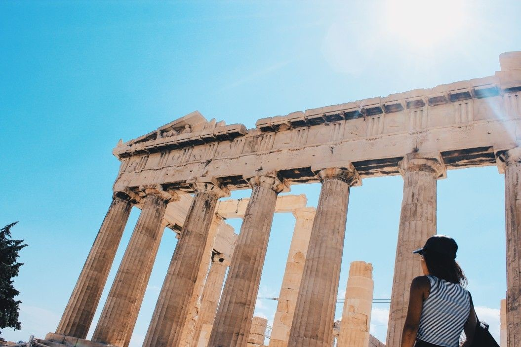 girl looking at the acropolis athens greece t Kkwzx