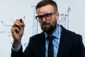 man draws various growth charts calculating PKCASUU