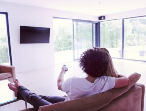 rear view of couple watching television PYEVWAK