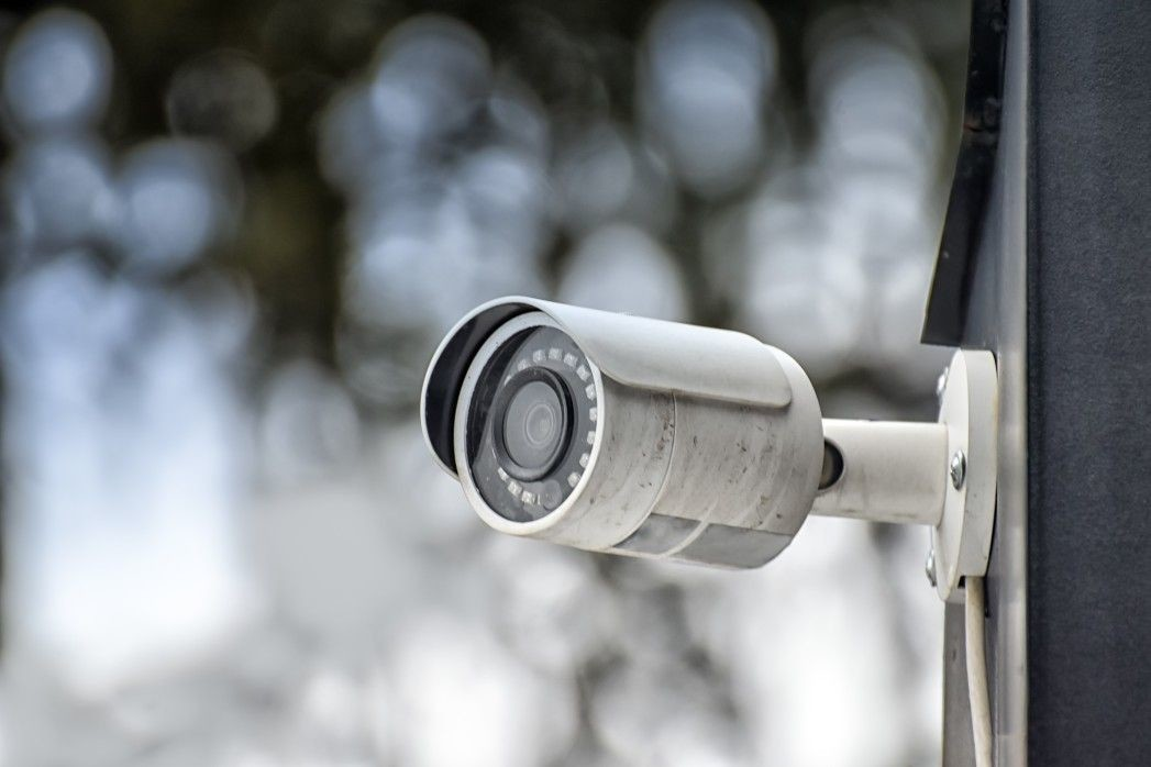 security-system-of-outdoor-video-surveillance-cctv-security-camera-on-blurred-outdoors-background_t20_GJjXe0