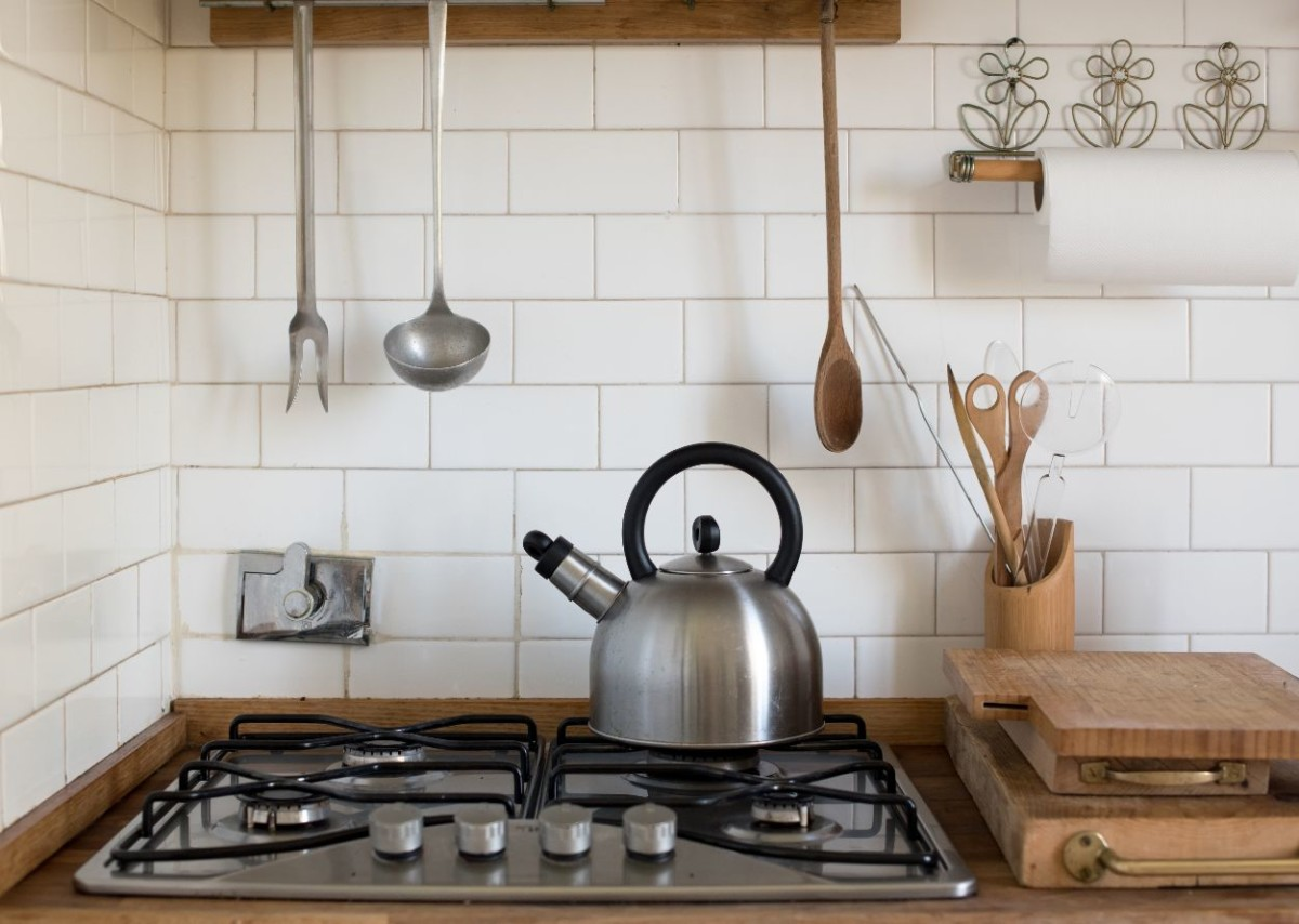 stainless steel kettle on a gas burner UCJZS