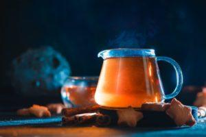 star cookies with glass teapot on a dark DJMEYAC