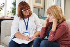 support worker visits senior woman suffering with PZTN