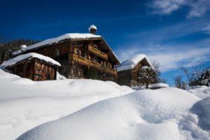 traditional ski resort chalets in the snow BTGQNGB