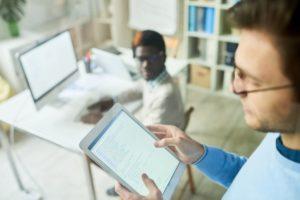 web developer holding tablet RFQV