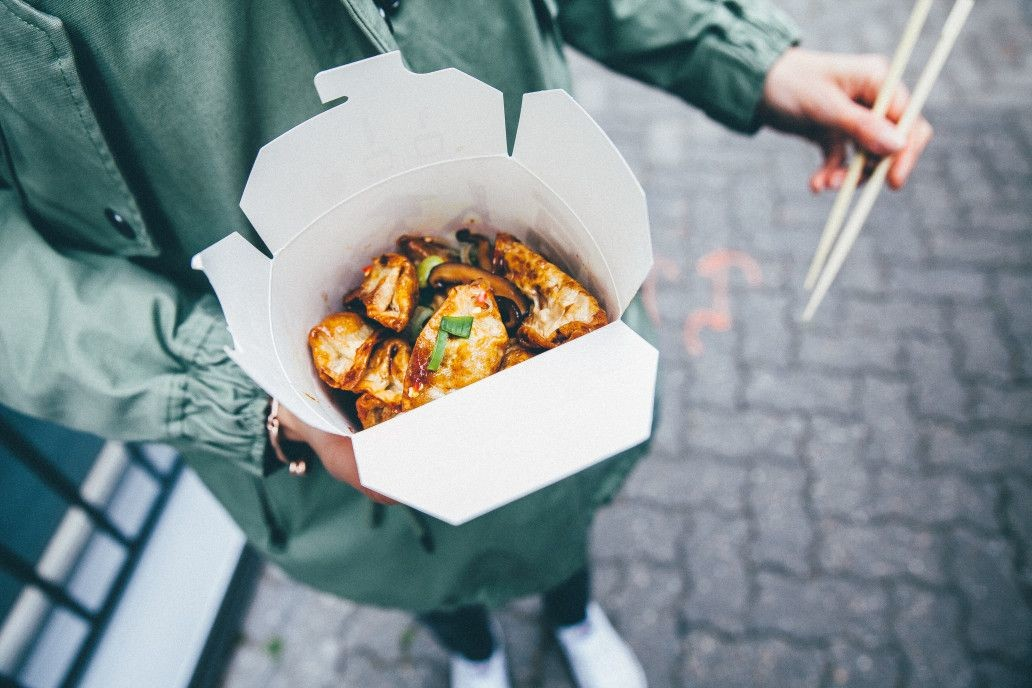 food-holding-street-hands-japanese-takeaway-street-food_t20_ZzbX1n