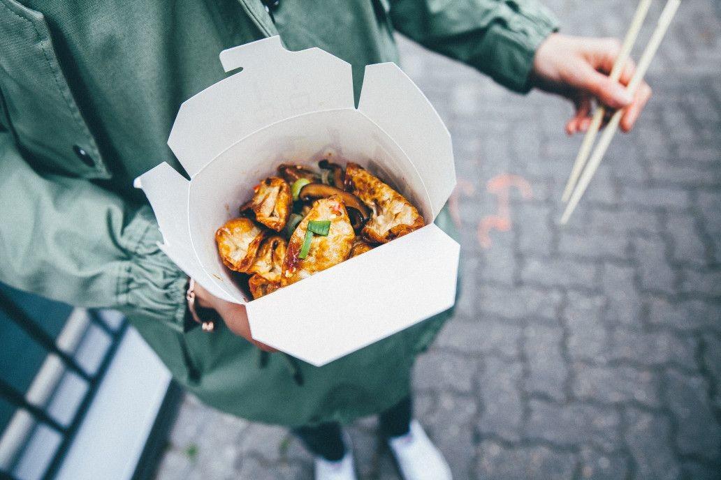 food holding street hands japanese takeaway street food t ZzbXn