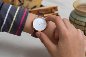 girls hand with wrist watches at the coffee break PCUB