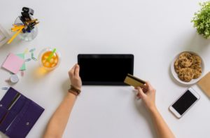 hands with tablet pc and credit card at table PSKHW