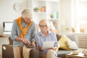 senior couple calculating budget VNWPL