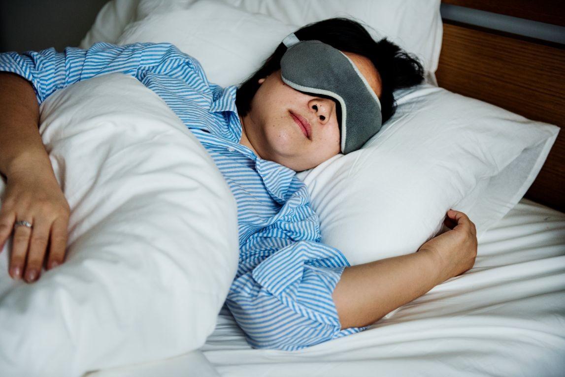 a woman sleeping PQZWG