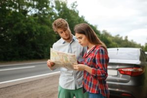 car tourists looking on map road travel CET