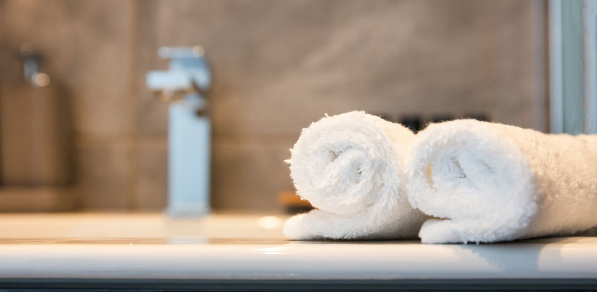 luxury bathroom sink and white towels closeup ABNSZJ