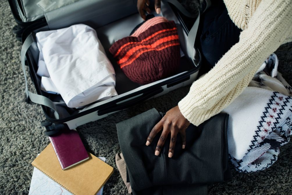 people packing for a trip PTX