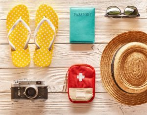 travel and beach items flat lay PPWGC