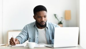 unemployed man using laptop searching for CPFFWR