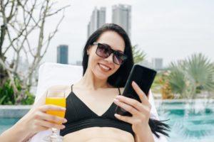 young woman checking social media JWHNLA