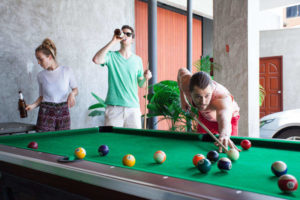 Backpackers Playing Pool