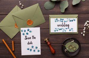 preparing wedding invitations and folding envelope RFQYM