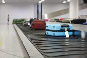 suitcase or luggage on conveyor belt in the airpor PLDJWV