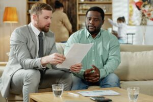 black man with consultant on mortgage LYZXGB